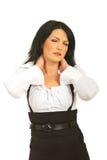 Mujer de negocios con dolor de cuello Fotografía de archivo libre de regalías