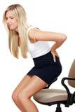 Mujer de negocios con dolor de espalda fotografía de archivo libre de regalías