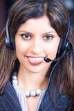 Mujer de negocios con el auricular fotografía de archivo libre de regalías