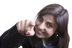 Mujer de negocios con el dedo que señala en usted Imagen de archivo