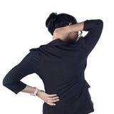 Mujer de negocios con el fondo del blanco del dolor de espalda Foto de archivo libre de regalías