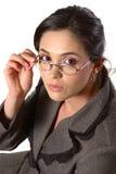 Mujer de negocios con el primer de los vidrios fotos de archivo libres de regalías
