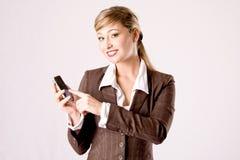 Mujer de negocios con el teléfono celular Foto de archivo libre de regalías