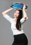 Mujer de negocios con exceso de trabajo Fotos de archivo