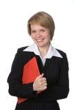 Mujer de negocios con la carpeta roja fotografía de archivo