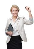 Mujer de negocios con la escritura del cojín en la pantalla invisible foto de archivo libre de regalías