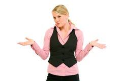 Mujer de negocios con la expresión confusa en cara Fotos de archivo libres de regalías