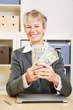 Mujer de negocios con la fan del dólar Imágenes de archivo libres de regalías