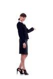 Mujer de negocios con su brazo hacia fuera Fotos de archivo