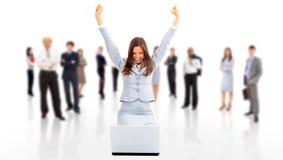 Mujer de negocios con sus manos levantadas Imagen de archivo