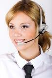 Mujer de negocios con un receptor de cabeza Fotografía de archivo libre de regalías