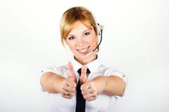 Mujer de negocios con un receptor de cabeza Imagenes de archivo