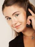 Mujer de negocios con un teléfono Imagen de archivo