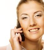Mujer de negocios con un teléfono Foto de archivo