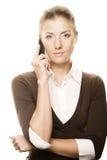 Mujer de negocios con un teléfono Foto de archivo libre de regalías