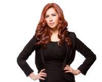 Mujer de negocios confiada en equipo negro Imagenes de archivo