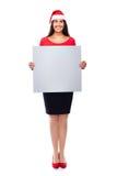 Mujer de negocios de la Navidad que lleva a cabo la muestra en blanco Imágenes de archivo libres de regalías