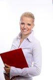 Mujer de negocios de mirada madura rubia en el smil blanco Foto de archivo libre de regalías