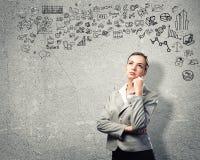 Mujer de negocios de pensamiento Foto de archivo libre de regalías
