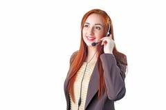Mujer de negocios del pelirrojo del operador de centro de atención telefónica Imagen de archivo libre de regalías