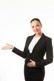 Mujer de negocios del pelo negro que levanta la mano Fotos de archivo