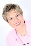 Mujer de negocios en color de rosa Fotos de archivo
