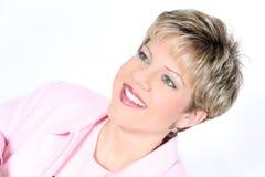 Mujer de negocios en color de rosa Imagen de archivo