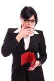 Mujer de negocios en cuestión con el dinero y la carpeta fotografía de archivo libre de regalías