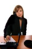 Mujer de negocios en el escritorio Foto de archivo libre de regalías