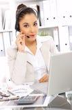 Mujer de negocios en oficina Imagen de archivo libre de regalías