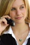 Mujer de negocios en un teléfono celular imagenes de archivo