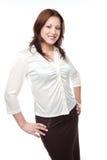 Mujer de negocios en una blusa y una falda blancas Fotos de archivo libres de regalías