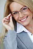 Mujer de negocios en vidrios Fotografía de archivo libre de regalías