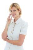 Mujer de negocios feliz en el teléfono imagen de archivo libre de regalías