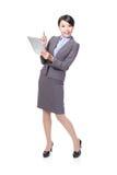 Mujer de negocios feliz usando la PC de la tablilla fotografía de archivo