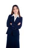 Mujer de negocios india asiática que sonríe con el juego azul Foto de archivo libre de regalías