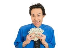 Mujer de negocios joven acertada emocionada feliz que lleva a cabo billetes de dólar del dinero fotos de archivo libres de regalías