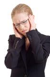 Mujer de negocios joven con dolor de cabeza Imágenes de archivo libres de regalías