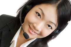 Mujer de negocios joven con el receptor de cabeza Imagenes de archivo