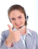 Mujer de negocios joven con las auriculares Fotos de archivo libres de regalías