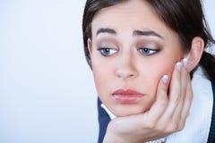 Mujer de negocios joven deprimida Foto de archivo libre de regalías