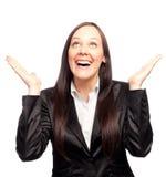Mujer de negocios joven emocionada con sus manos para arriba Fotografía de archivo libre de regalías