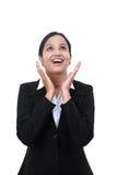 Mujer de negocios joven emocionada que mira para arriba Fotografía de archivo libre de regalías