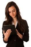 Mujer de negocios joven hermosa que mira la tableta que gesticula el succe Foto de archivo libre de regalías