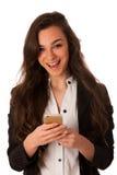 Mujer de negocios joven hermosa que muestra una nota feliz sobre ella elegante Fotos de archivo libres de regalías