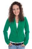 Mujer de negocios joven sonriente aislada en chaqueta verde con vaqueros Foto de archivo libre de regalías