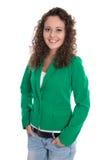 Mujer de negocios joven sonriente aislada en chaqueta verde con vaqueros Foto de archivo