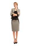 Mujer de negocios joven y elegante que se coloca con confianza Imagenes de archivo