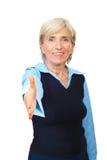 Mujer de negocios mayor del apretón de manos Fotografía de archivo libre de regalías