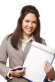 Mujer de negocios positiva que muestra el letrero en blanco Foto de archivo libre de regalías